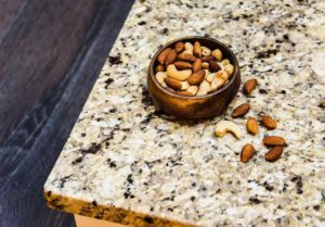 Nuts on a stone countertop.