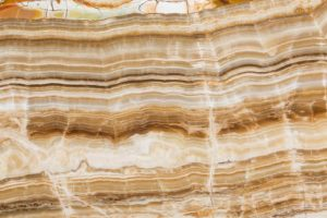 Up close image of cut and polished golden brown onyx stone