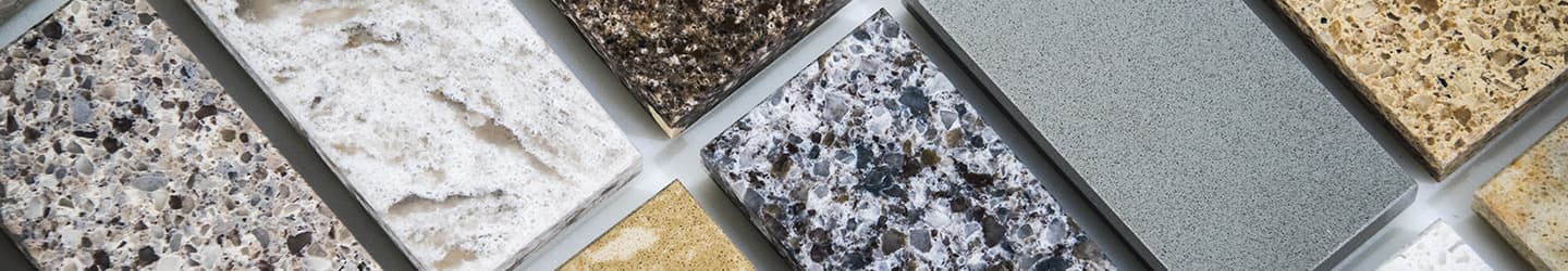 Samples of different tile products laid out for demonstration.